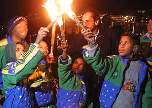 Former Brazilian street children and other at-risk community children lighting their torches of peace in Norway